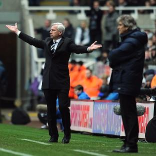 Alan Pardew, left, was sorry for his rant at Manuel Pellegrini