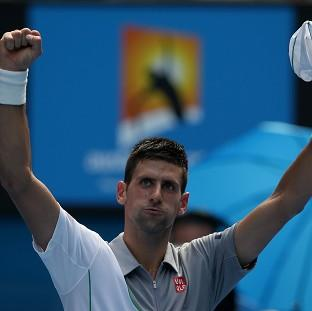 Hampshire Chronicle: Novak Djokovic waves to the crowd after winning his second round match at the Australian Open tennis championship in Melbourne (AP)