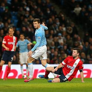 Edin Dzeko scores Man City's fifth goal of the game and 99th of the season