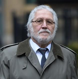 Former DJ Dave Lee Travis arrives at Southwark Crown Court in London, where he is accused of a series of indecent assaults and one sexual assault