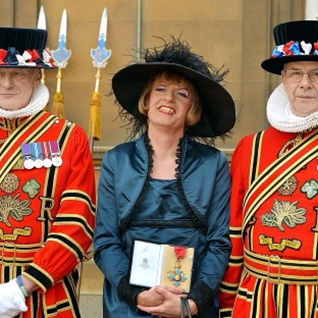 Hampshire Chronicle: Artist Grayson Perry holds his CBE presented to him by the Prince of Wales during an investiture ceremony at Buckingham Palace
