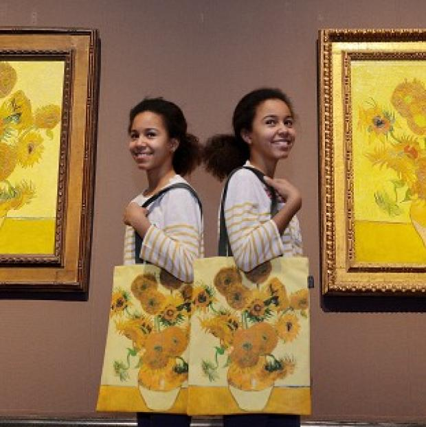 Hampshire Chronicle: A pair of Vincent Van Gogh's Sunflower paintings are on display in an exhibition at London's National Gallery
