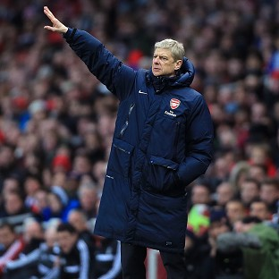 Arsene Wenger, pictured, poured cold water on rumours that Julian Draxler is on his way to Arsenal