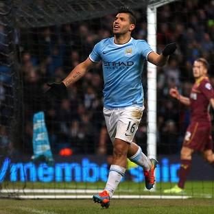 Sergio Aguero celebrates completing his hat-trick against Watford