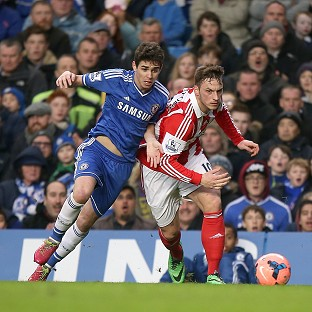 Oscar, left, scored against Stoke to see Chelsea through to the FA Cup fifth round