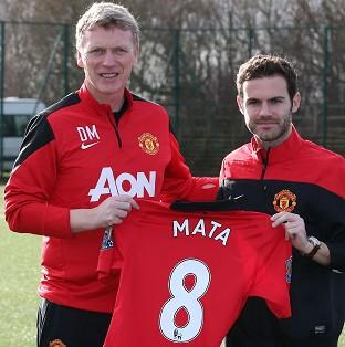 Juan Mata, right, is refusing to write off United's title hopes