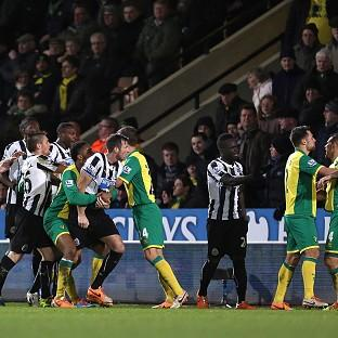 Norwich City's Bradley Johnson, right, saw red against Newcastle