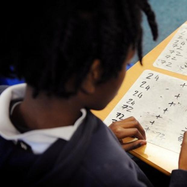 Hampshire Chronicle: A primary school pupil at work in a classroom
