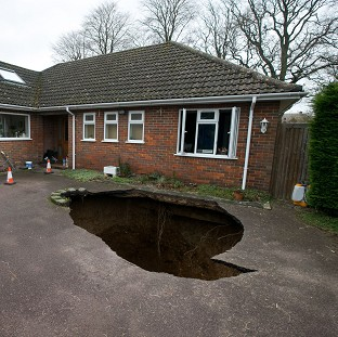 30ft sinkhole swallows family car