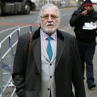 Former DJ Dave Lee Travis arrives at Southwark Crown Court in