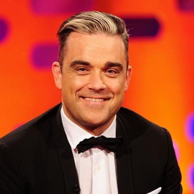 Hampshire Chronicle: Robbie Williams knows about his birthday surprise because it clashes with Stoke's celebrations