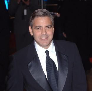 George Clooney says he won't join Twitter