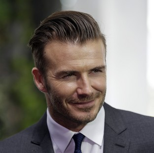 David Beckham listens to his wife's advice on clothes