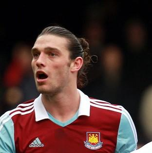 Andy Carroll, left, was sent off against Swansea after a clash with Chico Flores