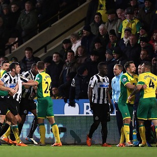 The unsavoury scenes overshadowed the clash at Carrow Road