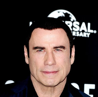 John Travolta would like to play a Bond villain