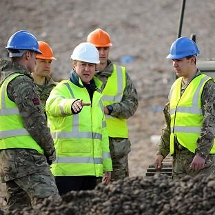 Hampshire Chronicle: Prime Minister David Cameron meets members of 39 Engineers as he inspects work being carried out on Chesil Beach between Portland and Weymouth in Dorset.