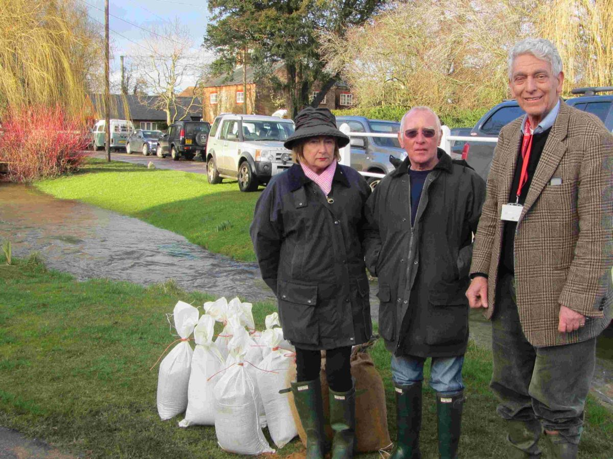 Harry Verney (right) in flood-hit Cheriton earlier this year