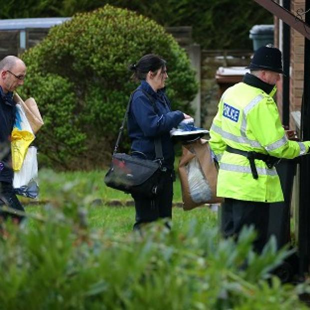 Hampshire Chronicle: Police forensic officers arrive at a house in Emily Street, Blackburn, after a baby girl died when she was mauled by a pet dog