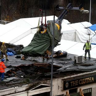 The wreckage of the police Eurocopter is lifted from the Clutha Vaults in Glasgow following