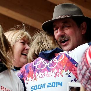 Lizzy Yarnold celebrates winning gold with her parents Judith and Clive Yarnold