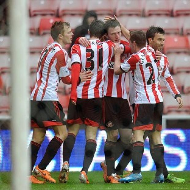 Hampshire Chronicle: Craig Gardner, centre, is congratulated by his Sunderland team-mates after scoring