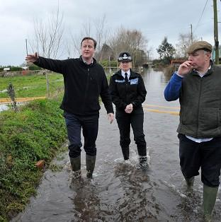 Hampshire Chronicle: Prime Minister David Cameron with Bridgwater and West Somerset MP Ian Liddell-Grainger at Goodings Farm in Fordgate, Somerset