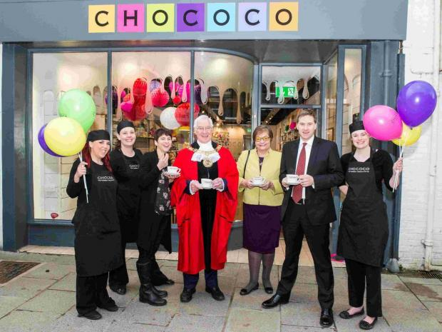 Hampshire Chronicle: Third from left and then ongoing - Claire Burnet, co-founder and chocolatier; The Mayor of Winchester, Cllr Ernie Jeffs; The Mayoress, Barbara Jeffs; and Steve Brine, MP for Winchester - with Chococo Winchester team members.