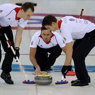 Great Britain's skip David Murdoch throws the last stone on their way to defeating Norway