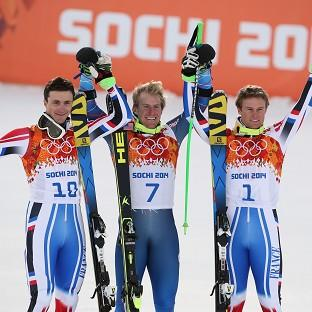 Ted Ligety, centre, celebrates his gold (AP)