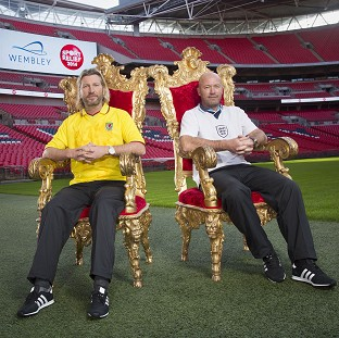 Alan Shearer and Robbie Savage will go head to head in the Sport Relief Battle of the Backsides - a race to be the first to sit on half the seats in Wembley Stadium (Sport Relief/PA)