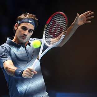 Roger Federer, pictured, overcame Benjamin Becker to move into the second round in Dubai