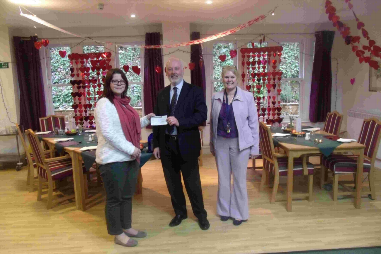 WINNERS: Kelly Inwood of the Alzheimer's Society is presented with a cheque by Pinders director Stephen Marriott and Teri Packer, home care manager at St Cross Grange.