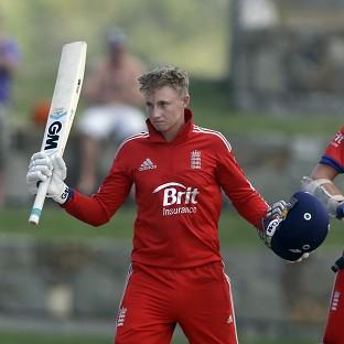 England's Joe Root, left, scored a century