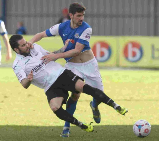 Eastleigh's Ben Strevens picked up a booking for this challenge on Weston's Kane Ingram.