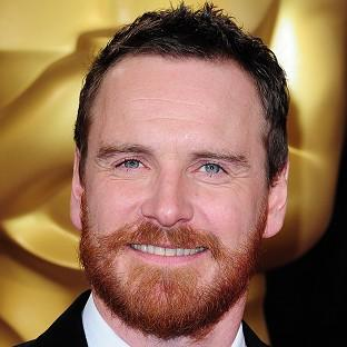 Michael Fassbender arriving at the 86th Academy Awards