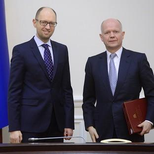 Hampshire Chronicle: Ukrainian Prime Minister Arseniy Yatsenyuk, left, and British Foreign Secretary William Hague