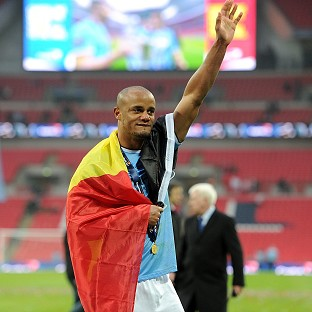 Vincent Kompany helped Manchester City to Capital One Cup glory