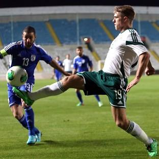 Cyprus' Konstantinos Makridis, left, and northern Ireland's Jamie Ward battle for the ball (AP)