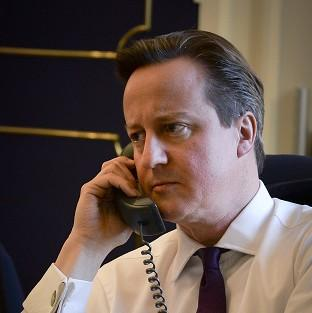 Hampshire Chronicle: David Cameron talking on the telephone to US President Barack Obama about the crisis in Ukraine (Prime Minister's Office/PA)