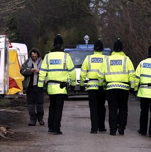 Police patrol a private road in Barton Moss, Greater Manchest