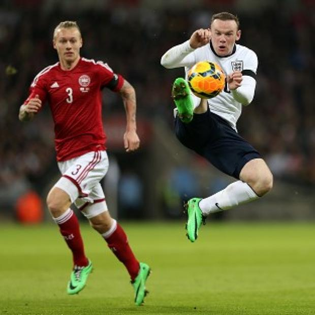Hampshire Chronicle: Wayne Rooney, right, felt England fully deserved their victory over Denmark