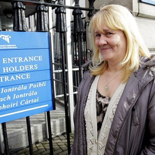Hampshire Chronicle: Sylvia Deehan arrives at court for her legal action against a pub after allegedly being injured during a rush to grab a free prize at an Ann Summers party.