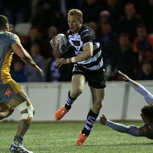 Kevin Brown, pictured centre, scored two late tries as Widnes beat Salford 32-18