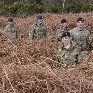 Hampshire Chronicle: Soldiers led by Army reservist Captain Leanne Christmas march along the front line trench of a newly discovered First World War practice battlefield in Gosport, Hampshire