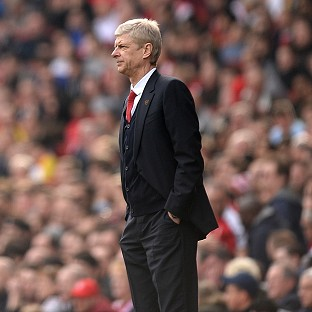 Arsenal manager Arsene Wenger, pictured, was full of praise for striker Olivier Giroud