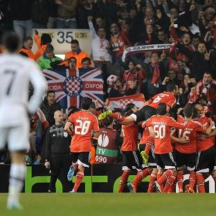 Benfica players celebrate after Luisao scores their second goal at White Hart Lane