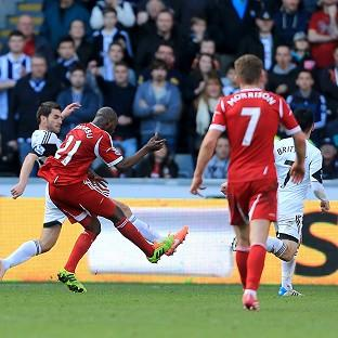 Youssouf Mulumbu, left, shoots to score the winner
