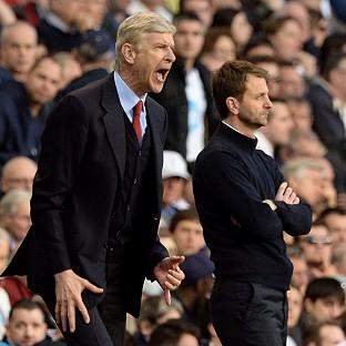 Arsene Wenger's side kept themselves in the race for the Premier League title by winning at Tottenham on Sunday