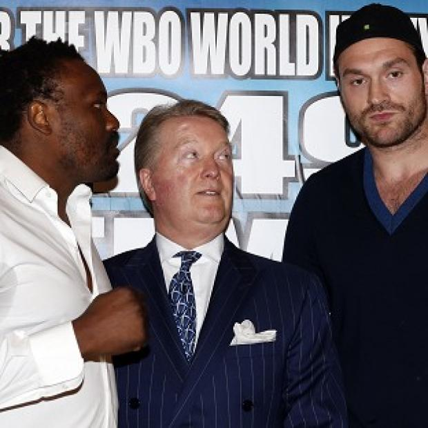 Hampshire Chronicle: Tyson Fury, right, will prepare to face Dereck Chisora with a fight behind closed doors